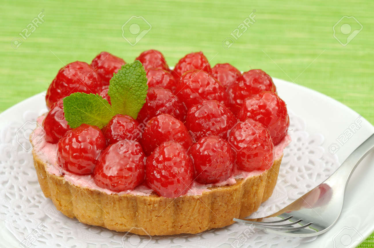 Fruit tartlet on a plate and green background Stock Photo - 6790074