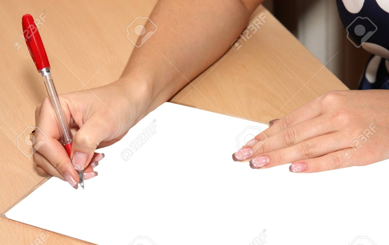 the girl holds writing handle near a clean sheet of paper Stock Photo - 15640902