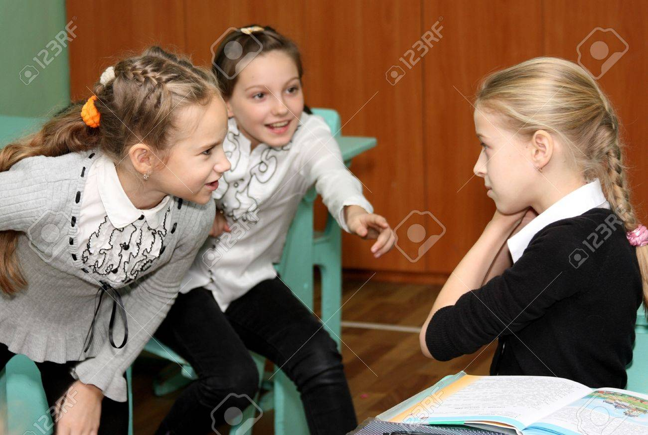 russian schoolgirl three schoolgirls talk at a lesson at the Russian school on December 5,  2012 Stock