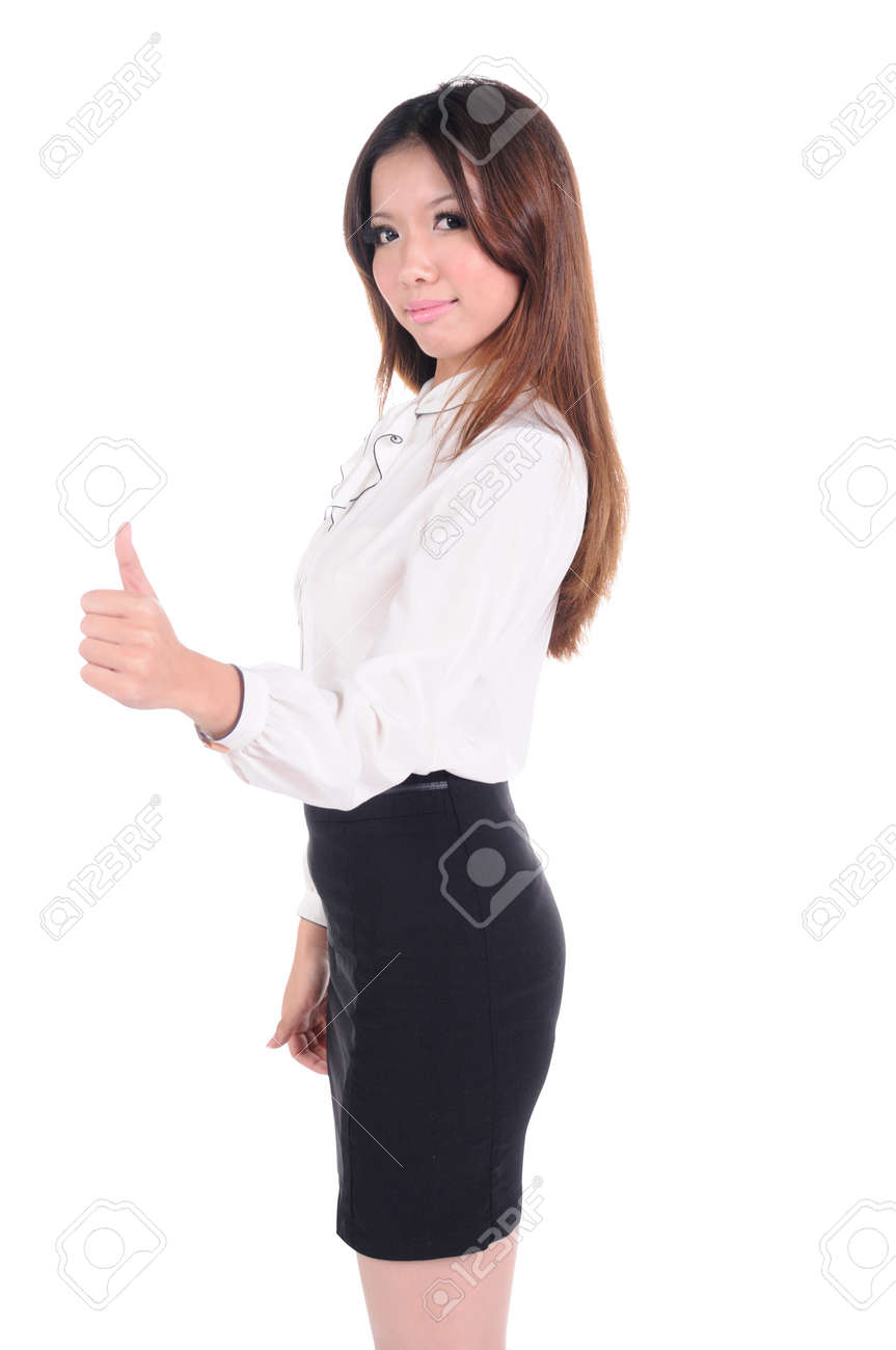young female shows thumb up gesture, isolated on white Stock Photo - 13684547