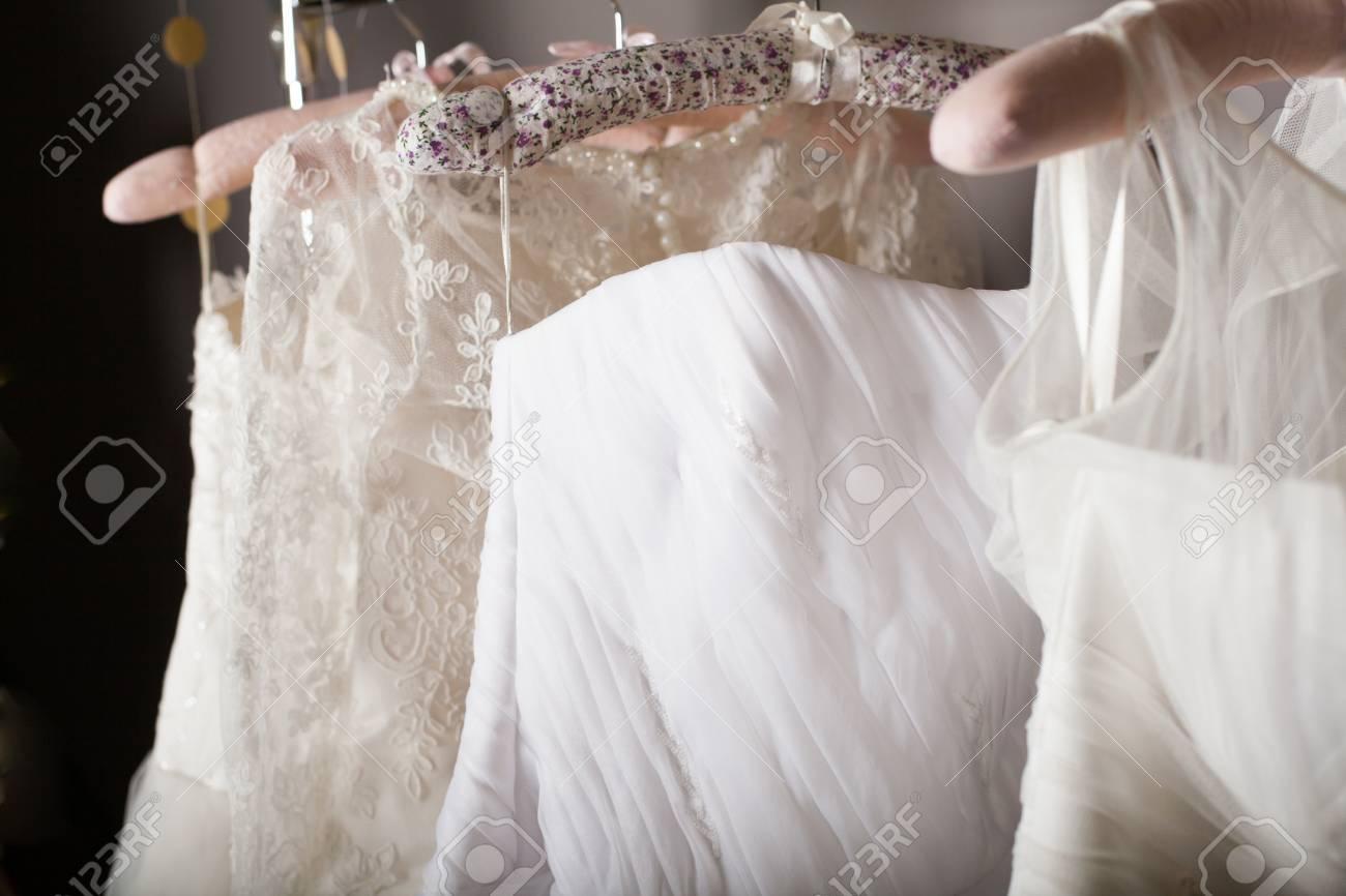 c8146053ec7ce Collection Of Wedding Dresses Hanging On Racks