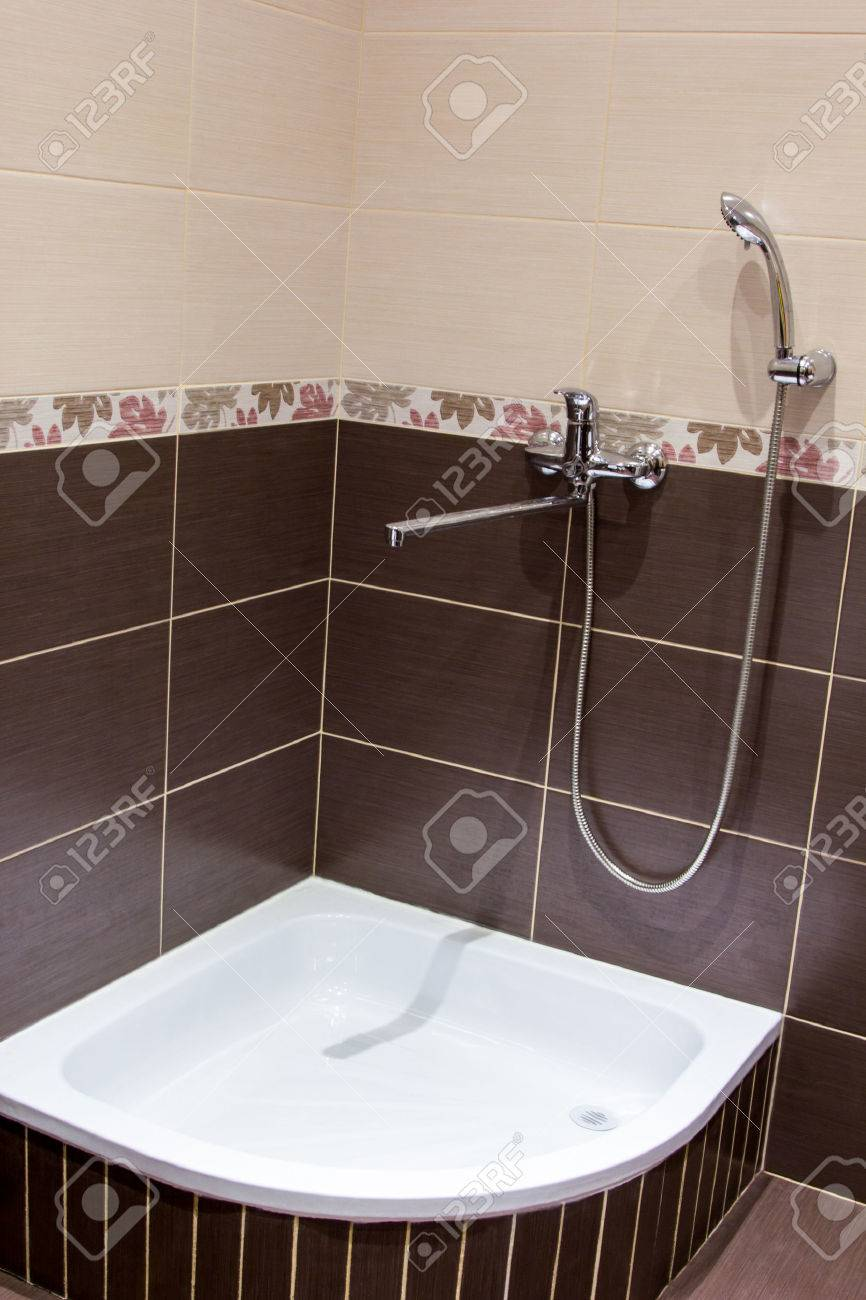 Shower Tray In The Bathroom Lined With Brown Tiles Stock Photo ...