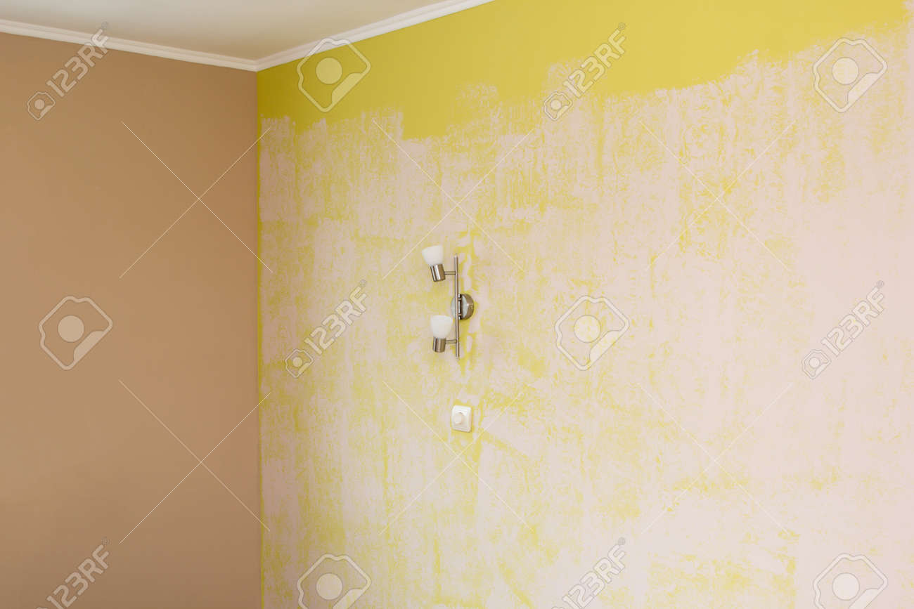 Yellow Wall Painted With A Textured Paint Roller Stock Photo ...