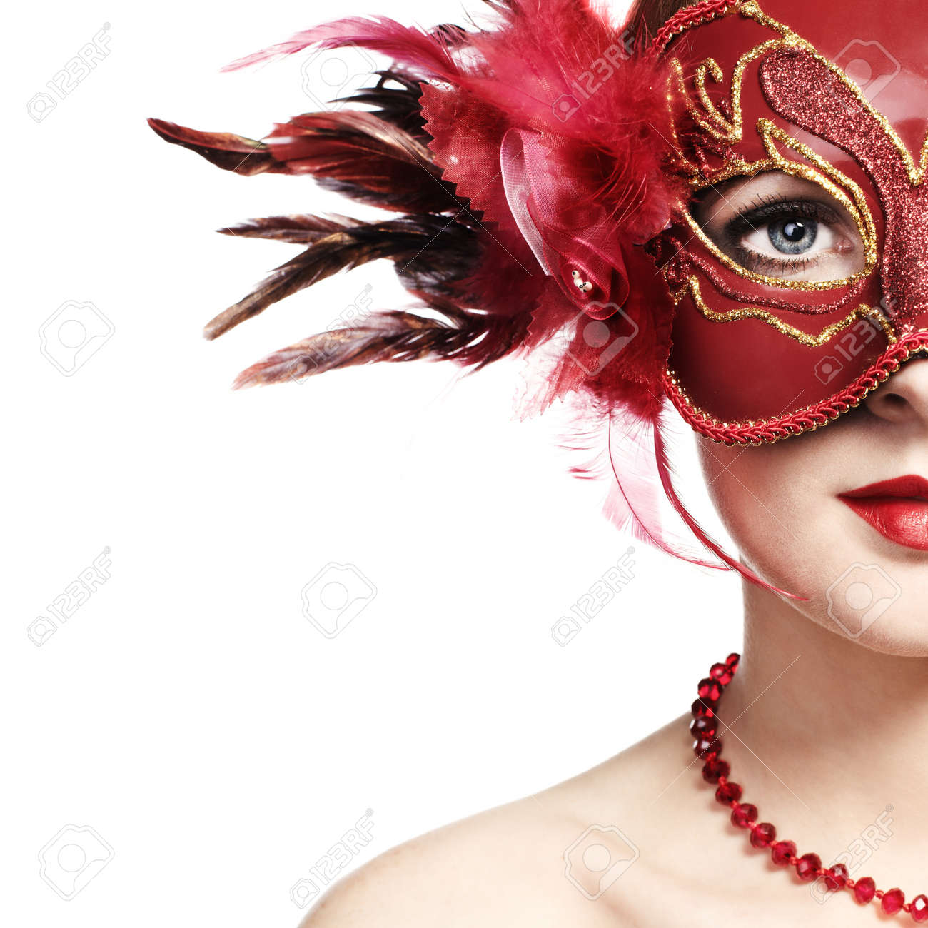 The beautiful young woman in a red mysterious venetian mask Stock Photo - 9314144