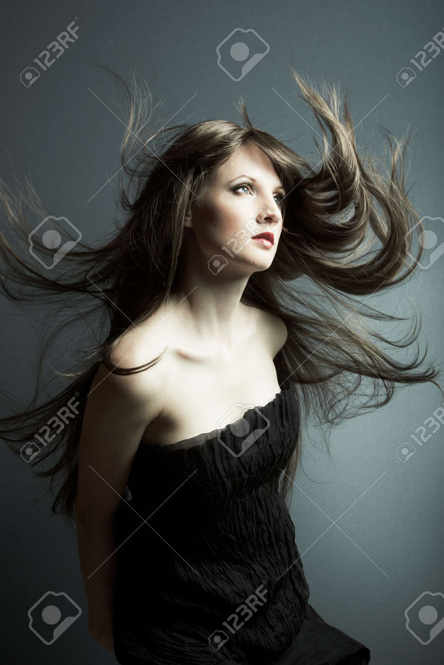 The young beautiful girl in black dress with developing hair - 9314271