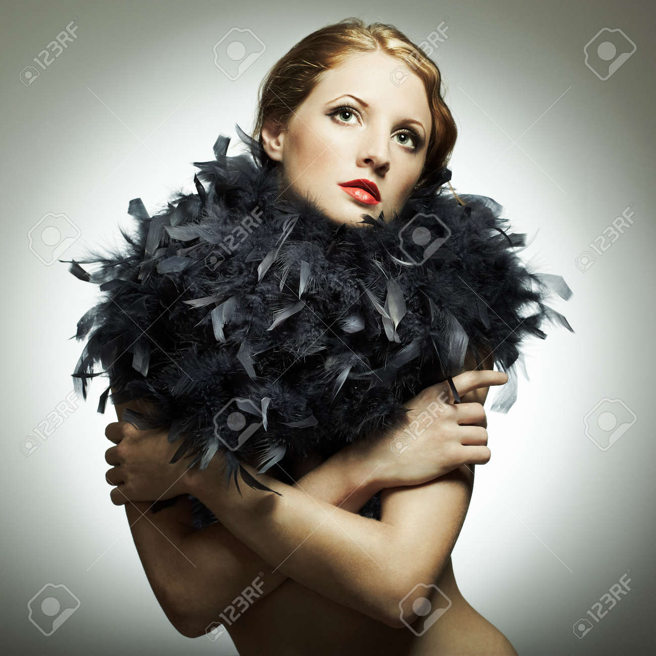Portrait of the young woman from a boa Stock Photo - 9314141