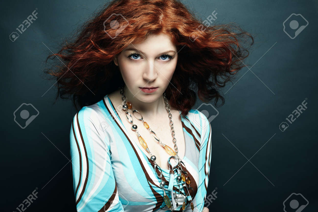Portrait of the young beautiful woman with curly hair Stock Photo - 9433228