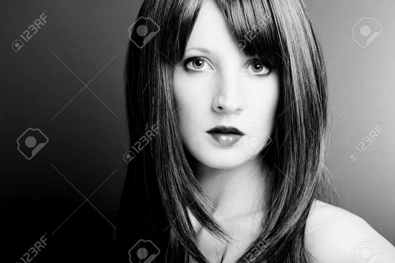 Portrait of the young sexual woman closeup. The Black-and-white photo Stock Photo - 9433177