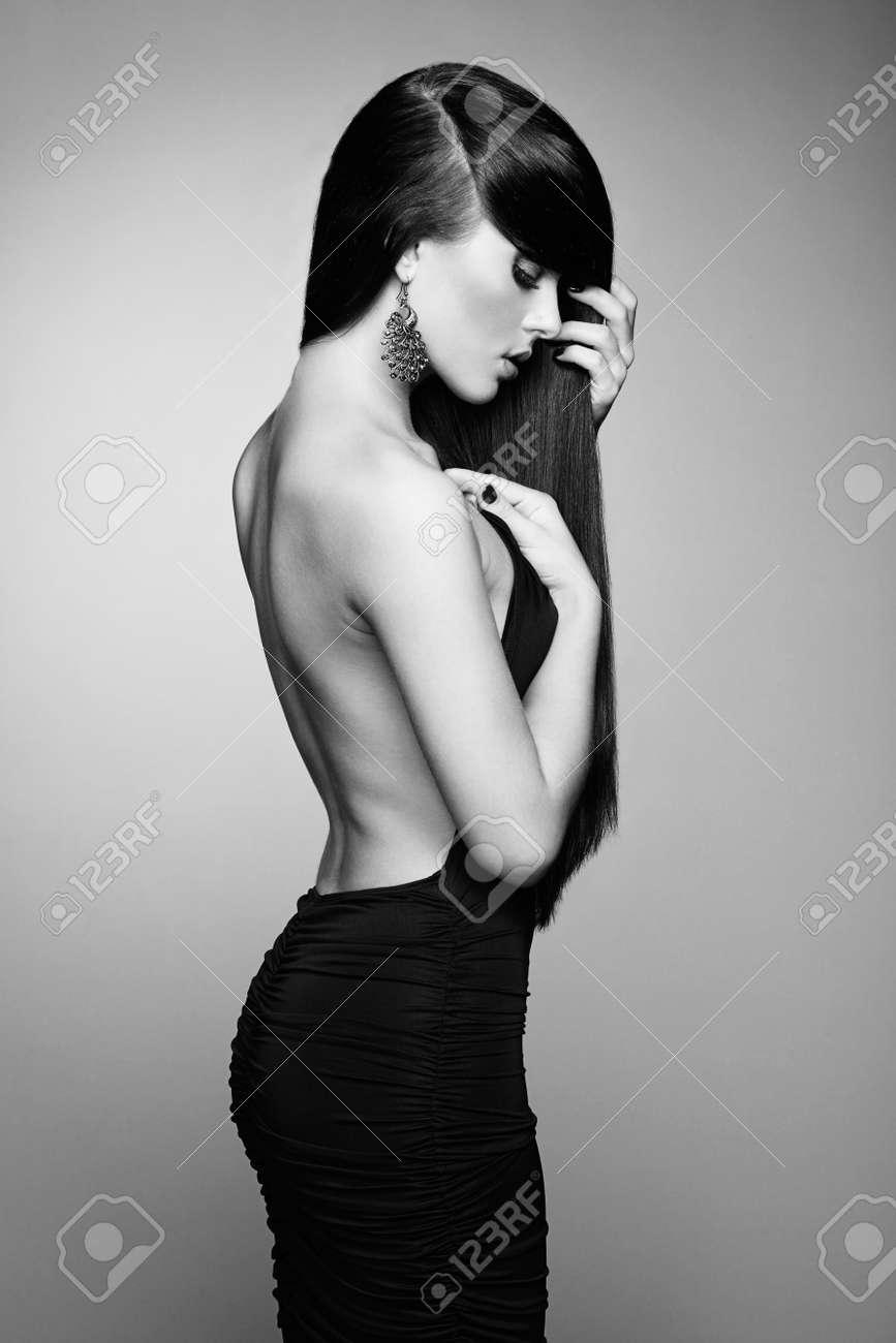 Portrait of beautiful brunette woman in black dress. Fashion photo Stock Photo - 21777735