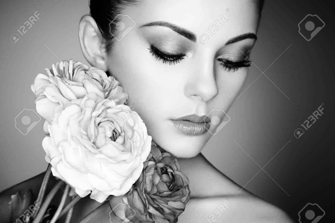 Black and white portrait of beautiful young woman with flowers perfect makeup perfect skin fashion photo
