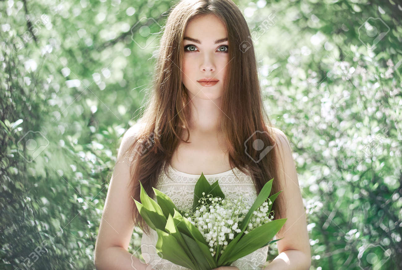 Lily of the valley stock photos royalty free lily of the valley images portrait of beautiful young woman with lily of the valley girl on nature spring izmirmasajfo