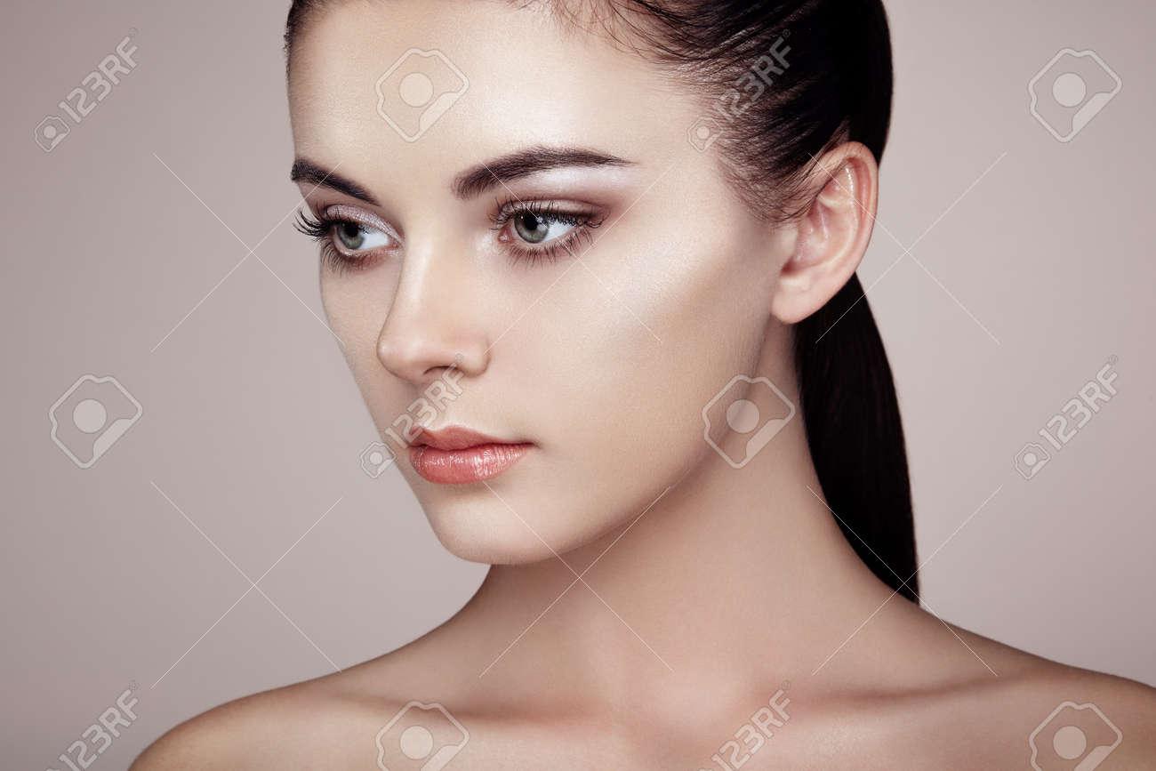 Beautiful woman face. Perfect makeup. Beauty fashion. Eyelashes. Cosmetic Eyeshadow. Highlighting Stock Photo - 44084443