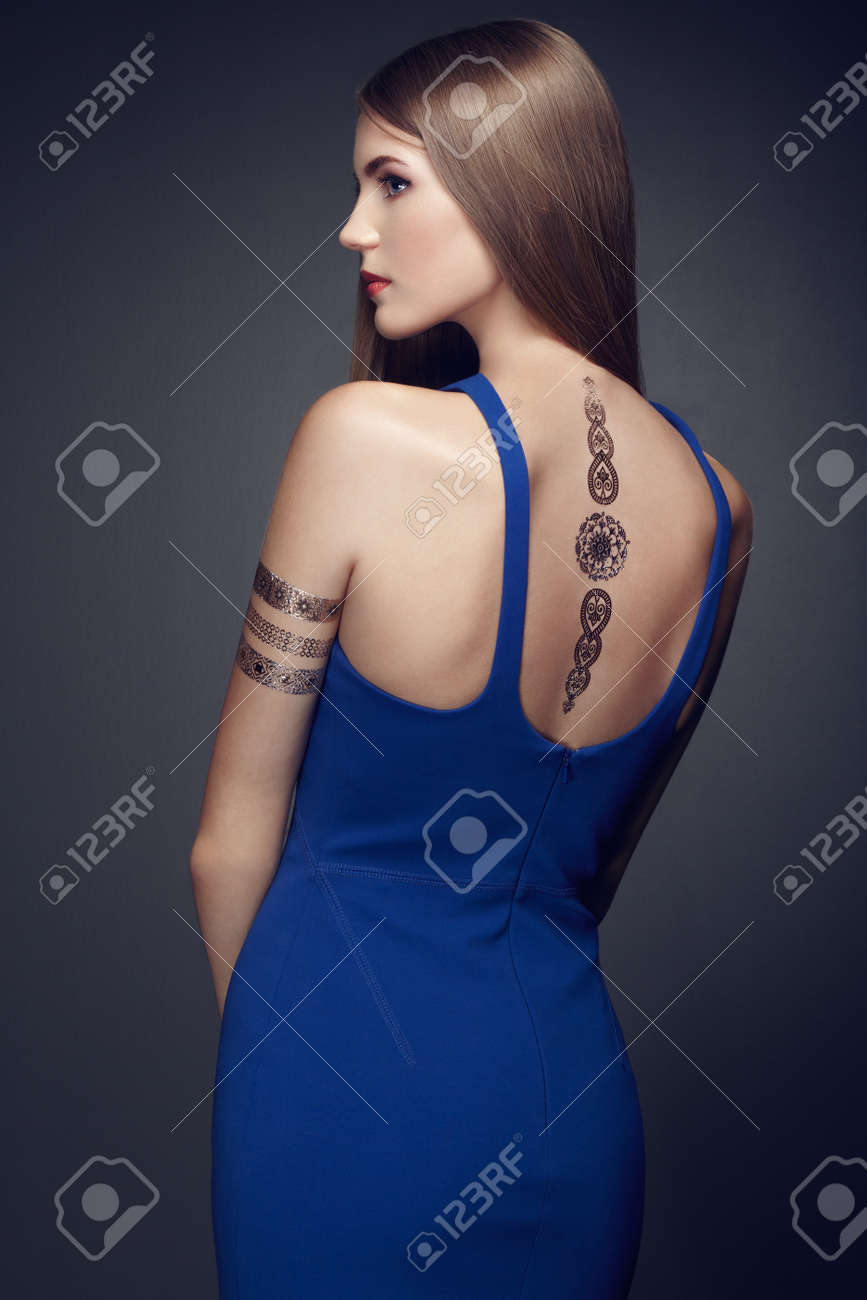 Fashion portrait of elegant woman with magnificent hair. blonde girl. Perfect make-up. Girl in elegant dress. Flash tattoo gold - 45166752