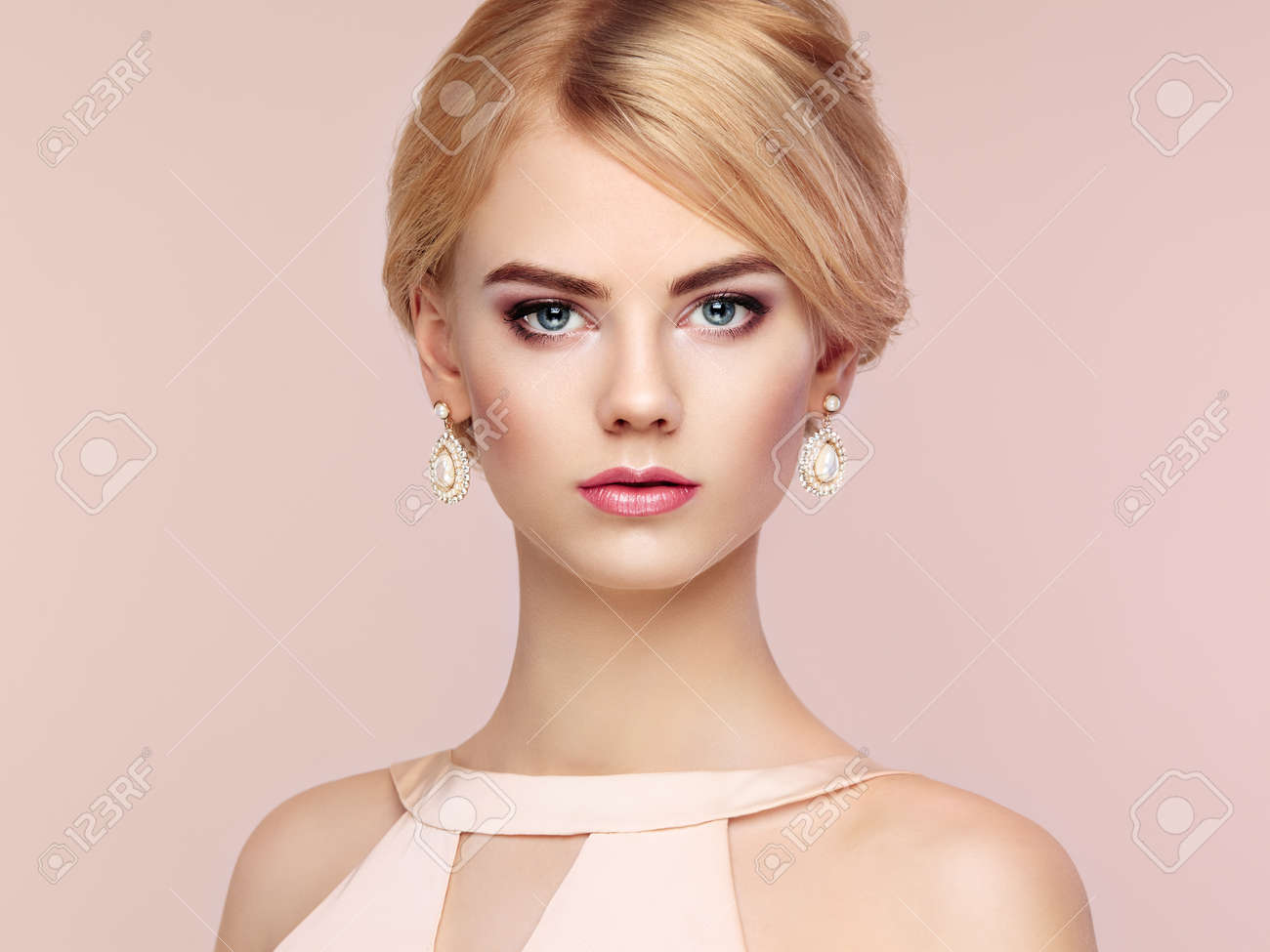 Portrait of beautiful sensual woman with elegant hairstyle. Perfect makeup. Blonde girl. Fashion photo. Jewelry and dress - 47595985