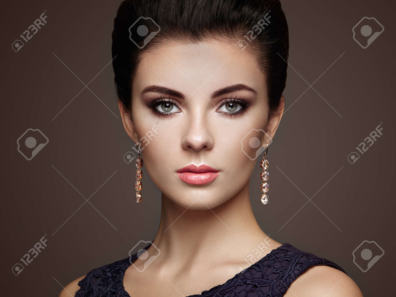 Fashion portrait of young beautiful woman with jewelry. Brunette girl. Perfect make-up. Beauty style woman with diamond accessories - 52548988