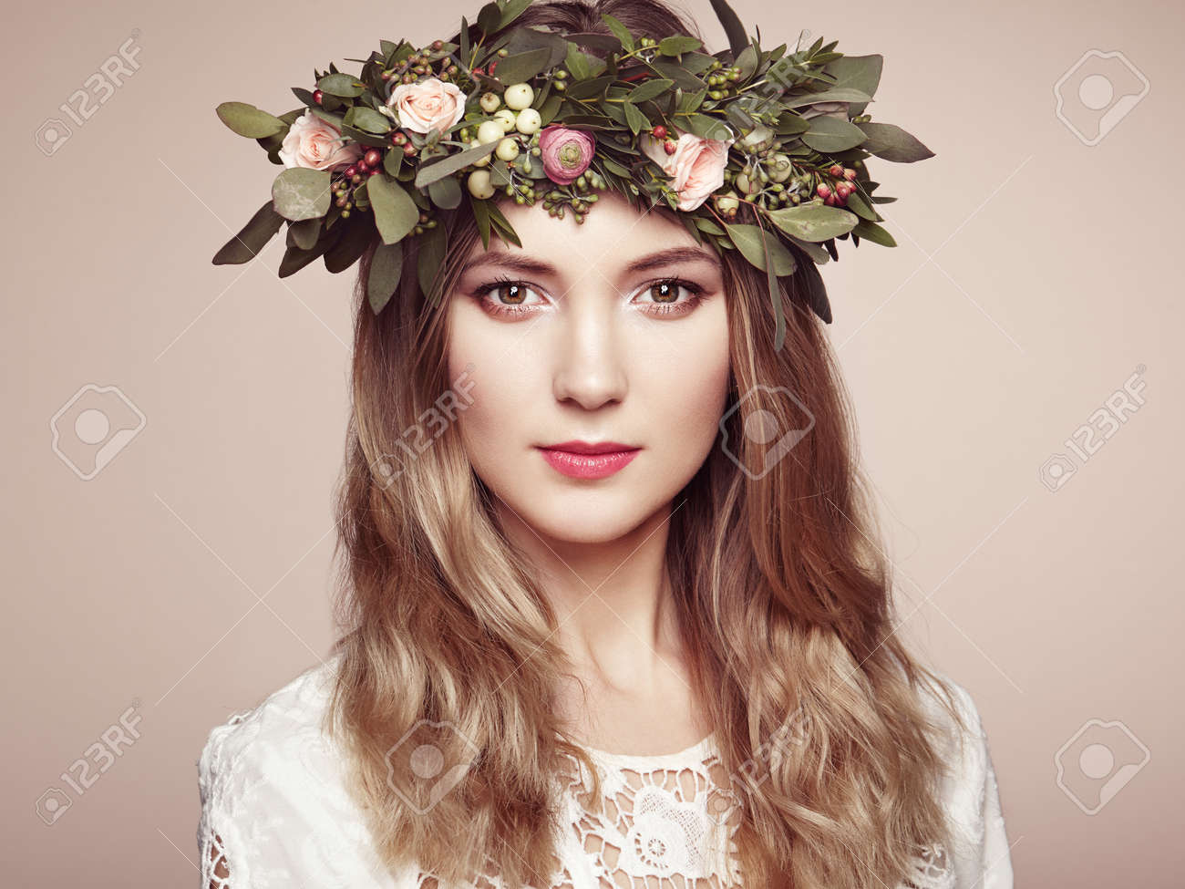 Beautiful blonde woman with flower wreath on her head beauty beautiful blonde woman with flower wreath on her head beauty girl with flowers hairstyle izmirmasajfo