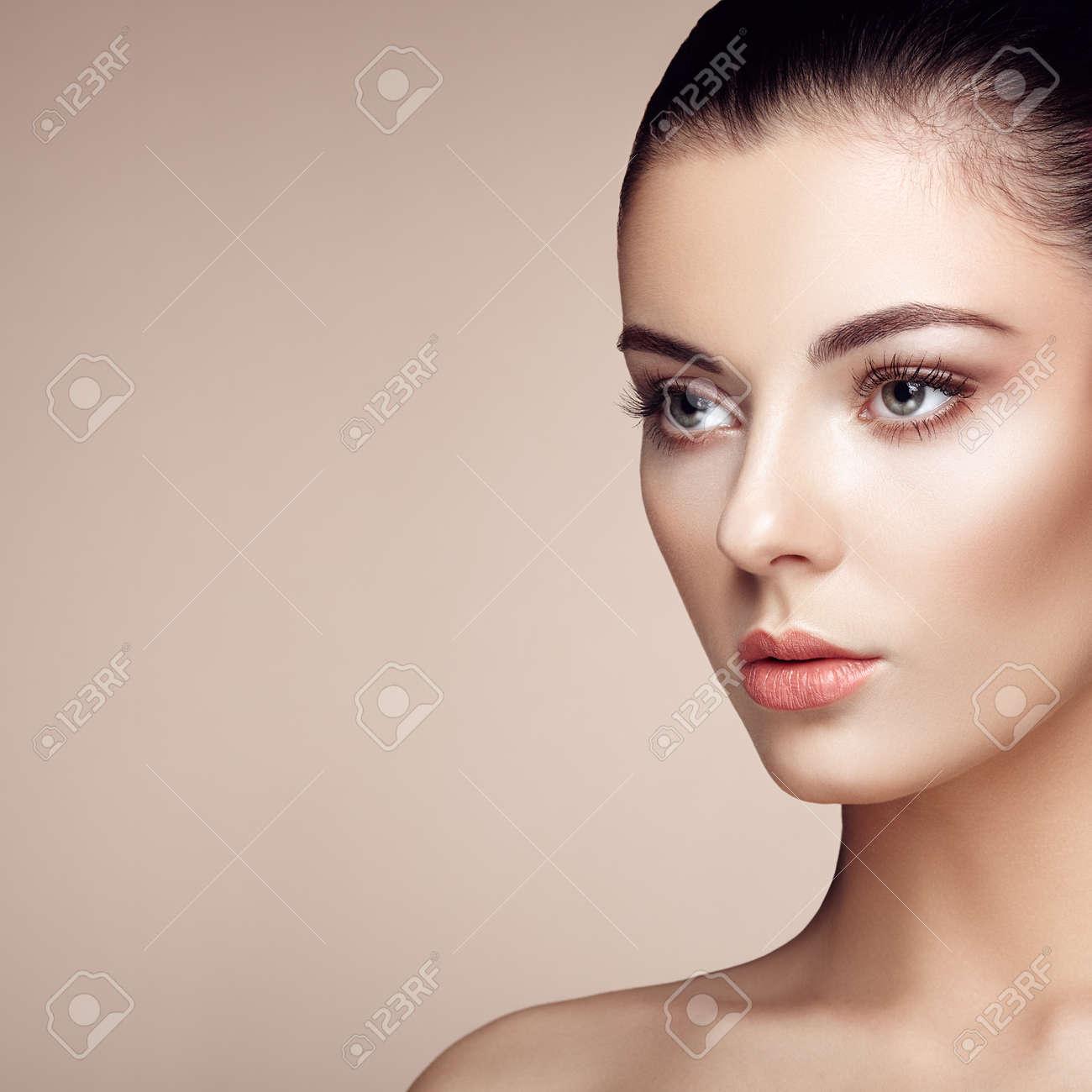 Beautiful woman face. Perfect makeup. Beauty fashion. Eyelashes. Cosmetic Eyeshadow. Highlighting - 54978499