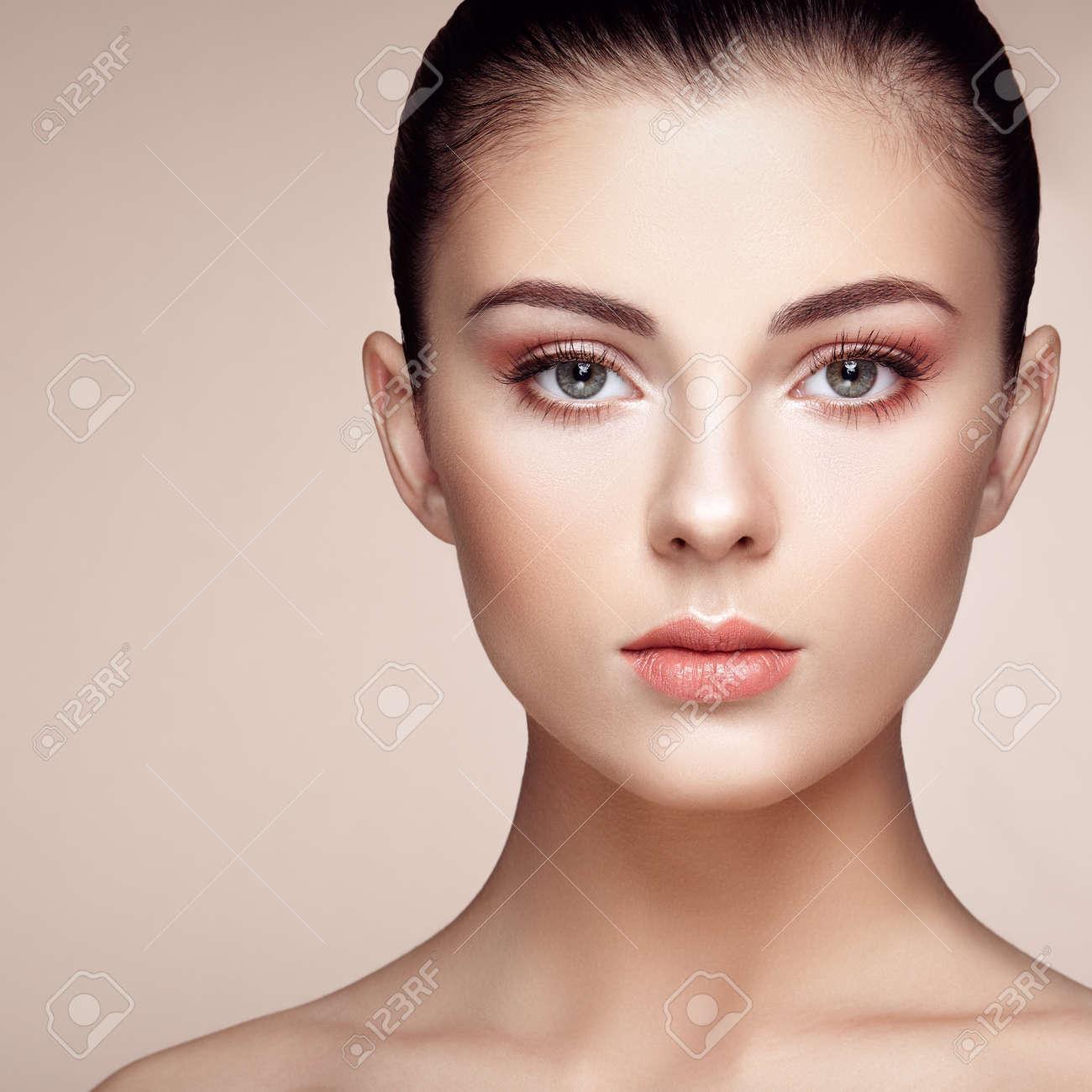 Beautiful woman face. Perfect makeup. Beauty fashion. Eyelashes. Cosmetic Eyeshadow. Highlighting