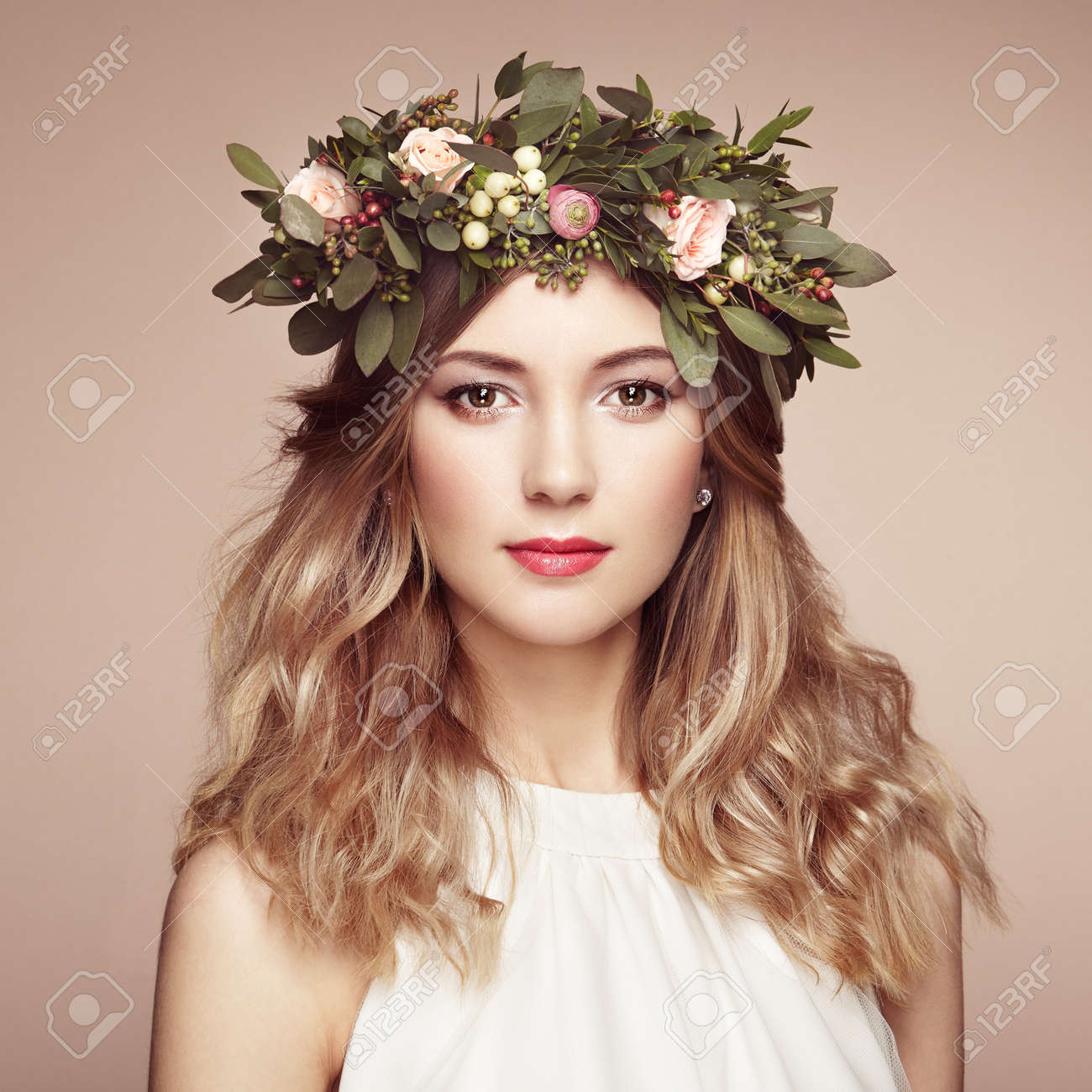 Beautiful blonde woman with flower wreath on her head. Beauty girl with flowers hairstyle. Perfect makeup. Beauty fashion. Spring woman - 54978512