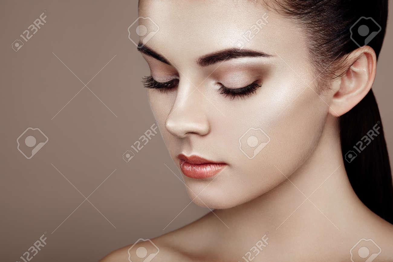 Beautiful woman face. Perfect makeup. Beauty fashion. Eyelashes. Cosmetic Eyeshadow. Highlighting Stock Photo - 55148415