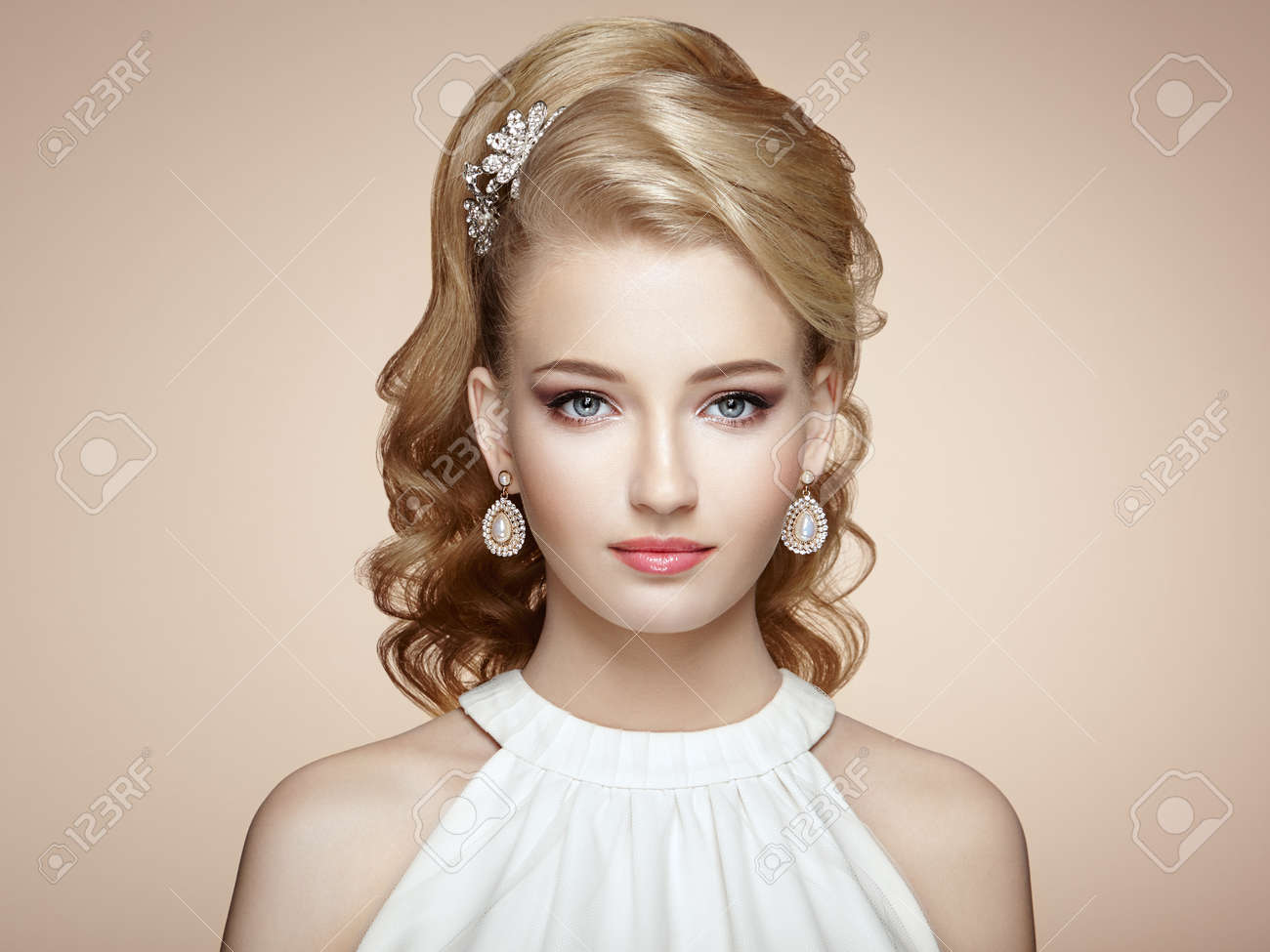 Fashion portrait of young beautiful woman with elegant hairstyle - 62369531