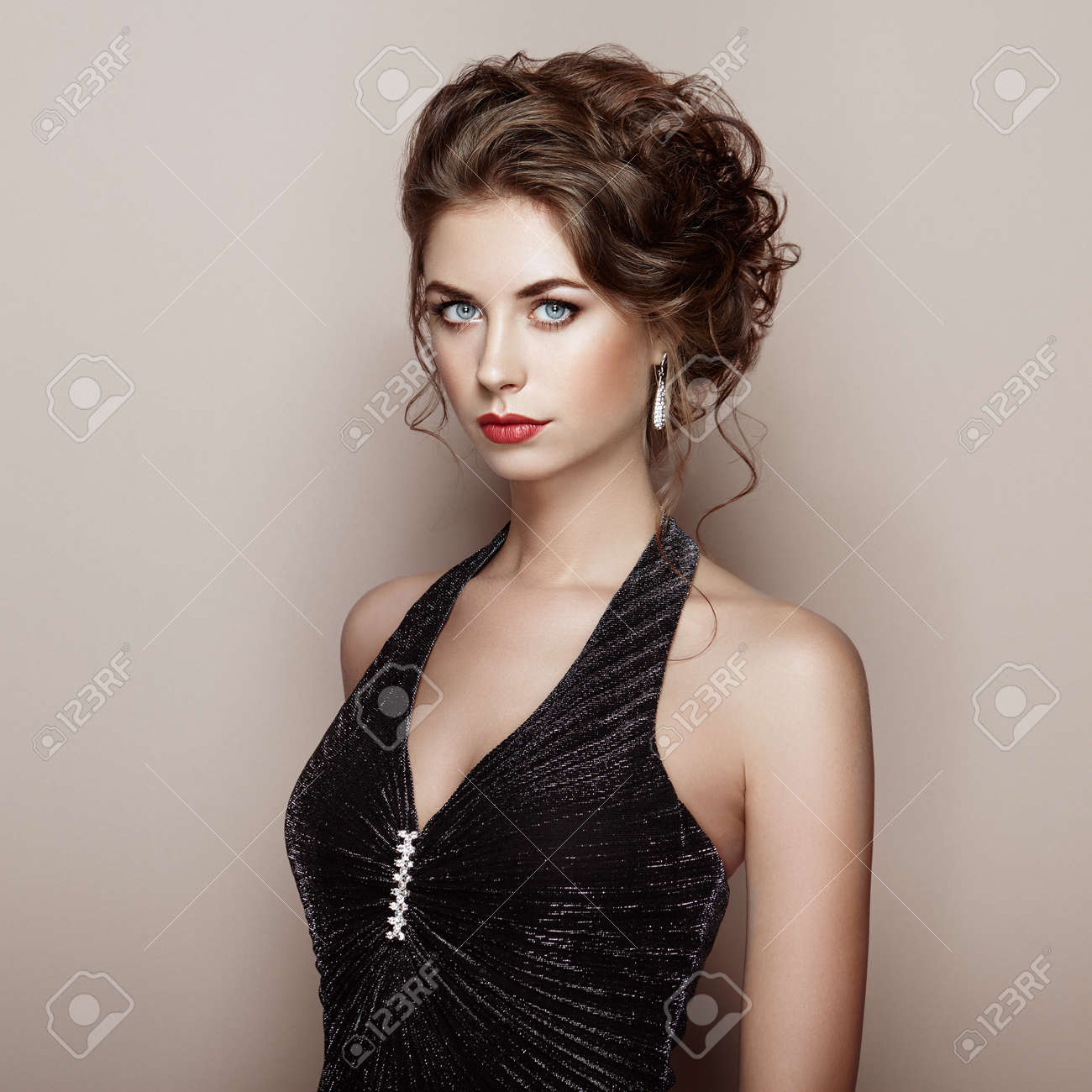 Fashion portrait of beautiful woman in elegant dress. Girl with elegant hairstyle and jewelry - 64357837