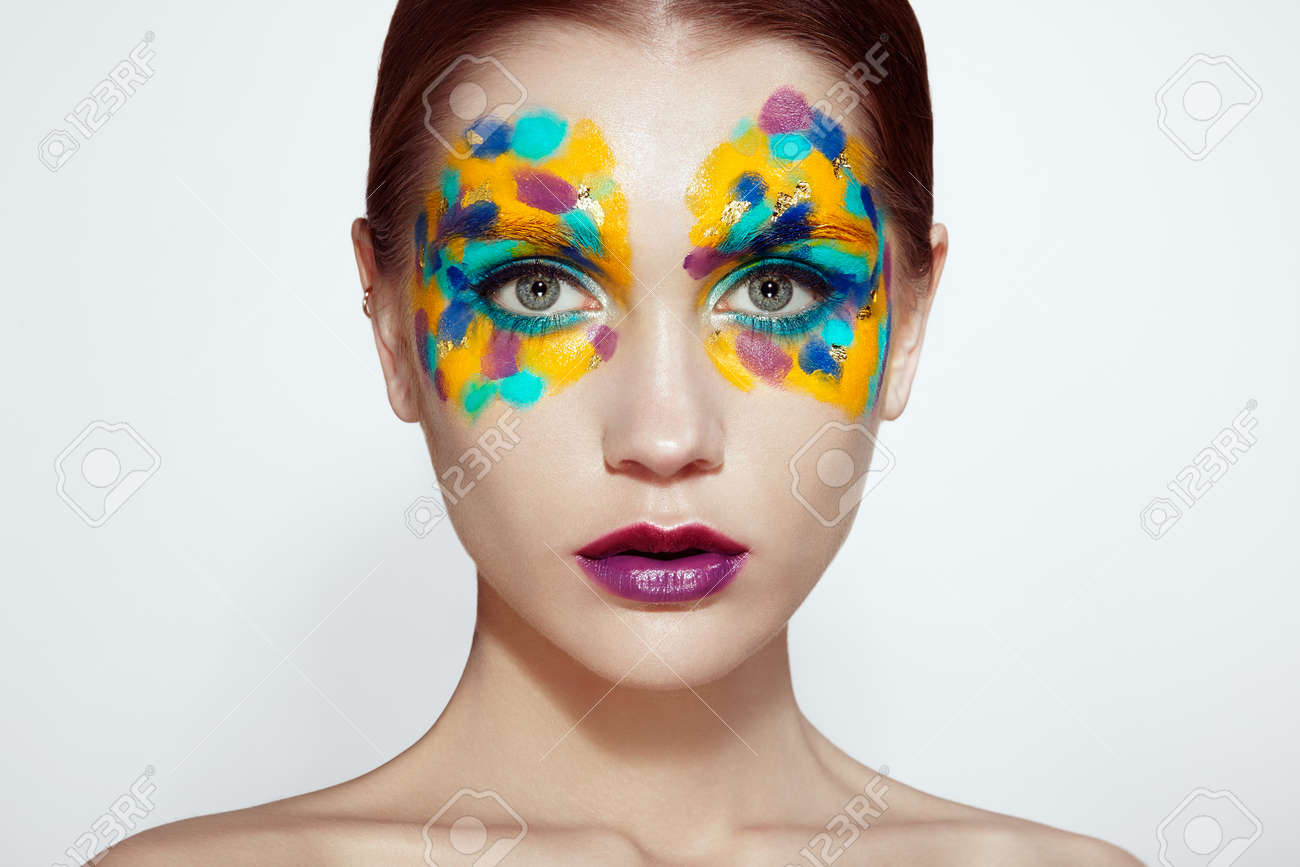 Beautiful woman face. Beauty girl face with colorful makeup. Beauty fashion. Eyelashes.