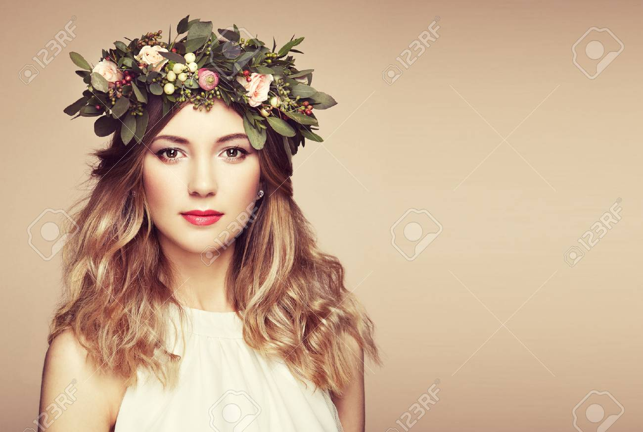 Beautiful blonde woman with flower wreath on her head. Beauty girl with flowers hairstyle. Perfect makeup. Beauty fashion. Spring woman - 70503695