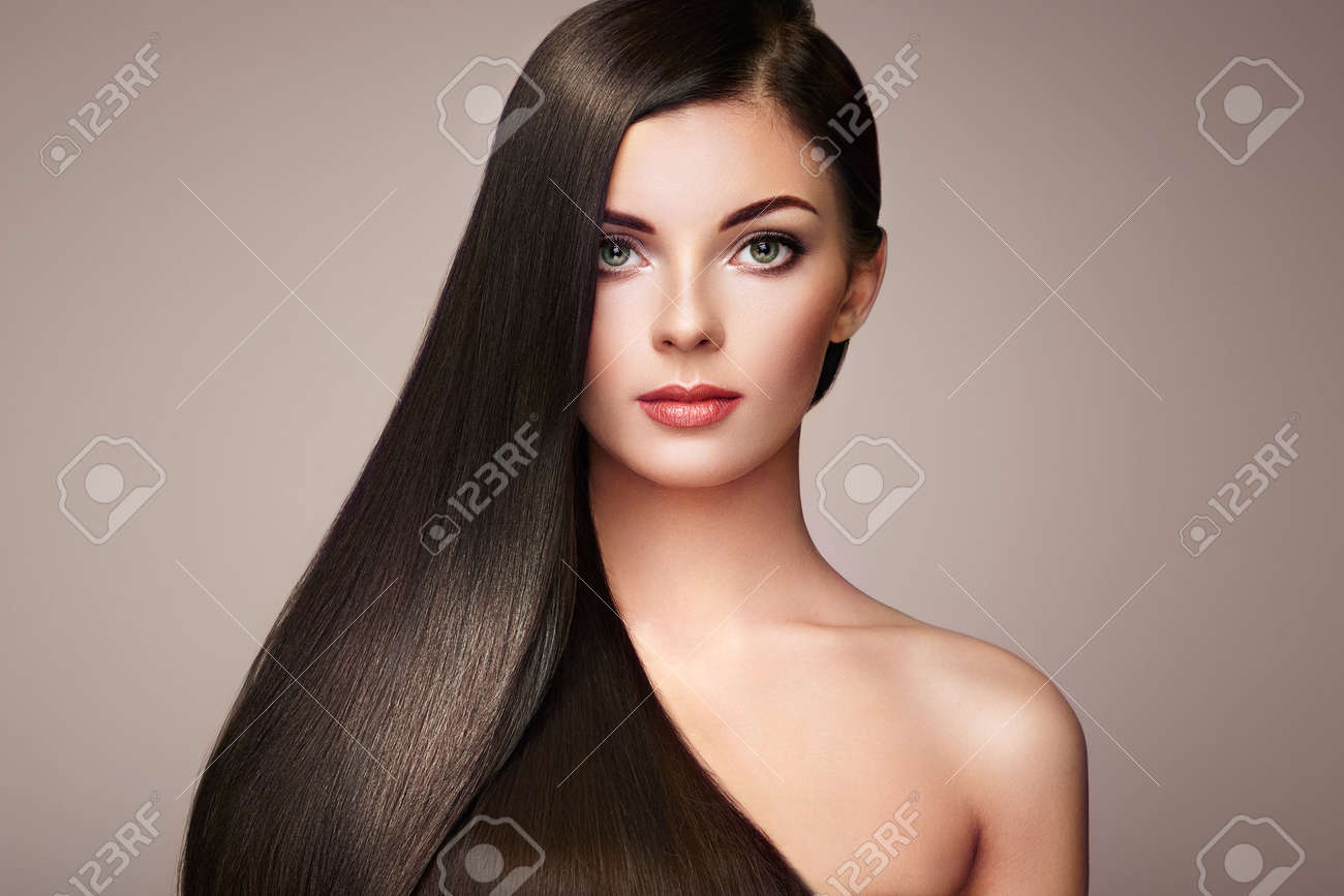 Beautiful woman with long smooth hair. Girl with perfect makeup and hairstyle. Model brunette with perfect healthy dark hair - 75527870