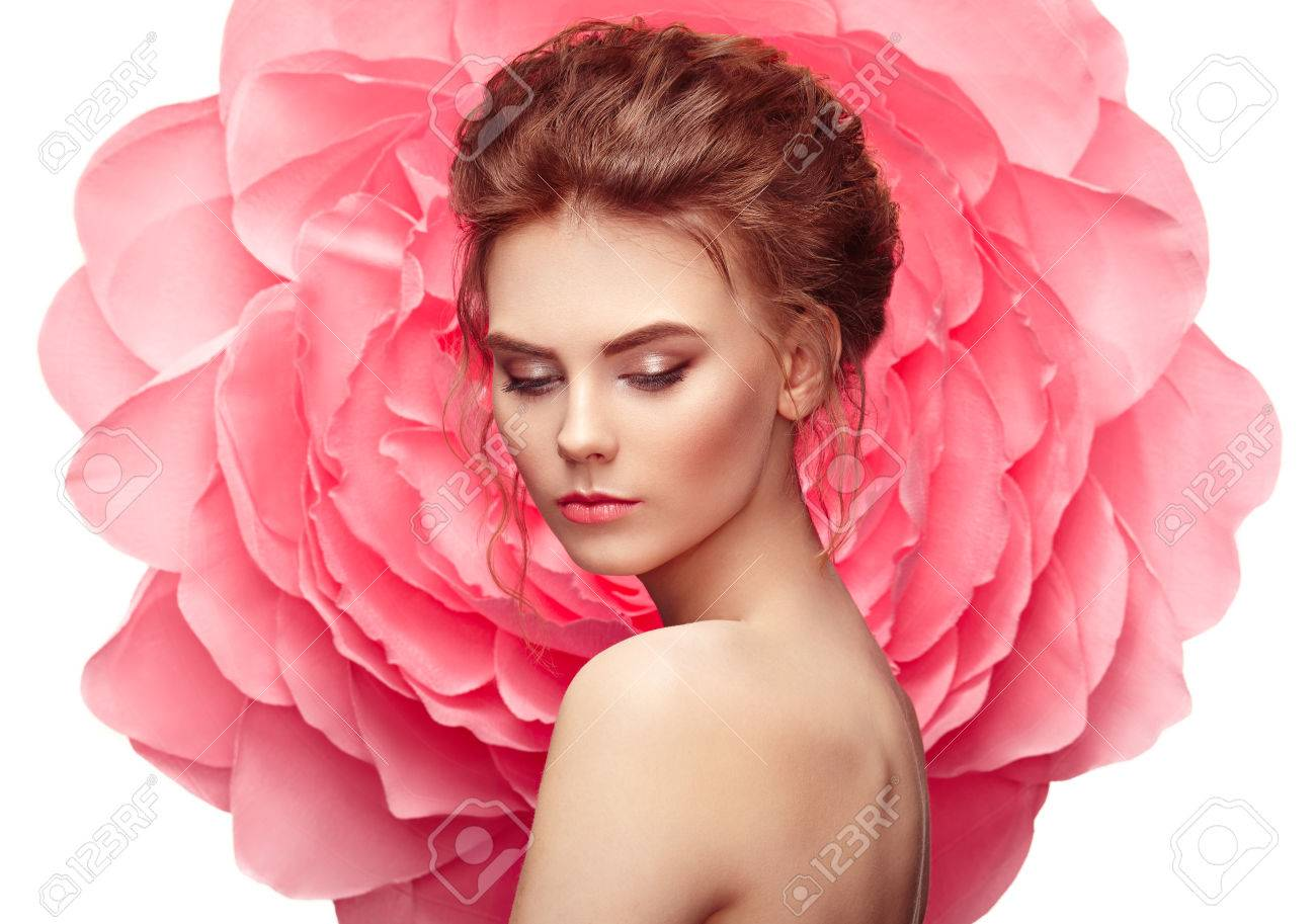 Beautiful woman on the background of a large flower. Beauty summer model girl with pink peony. Young woman with elegant hairstyle and makeup. Fashion photo - 77932290