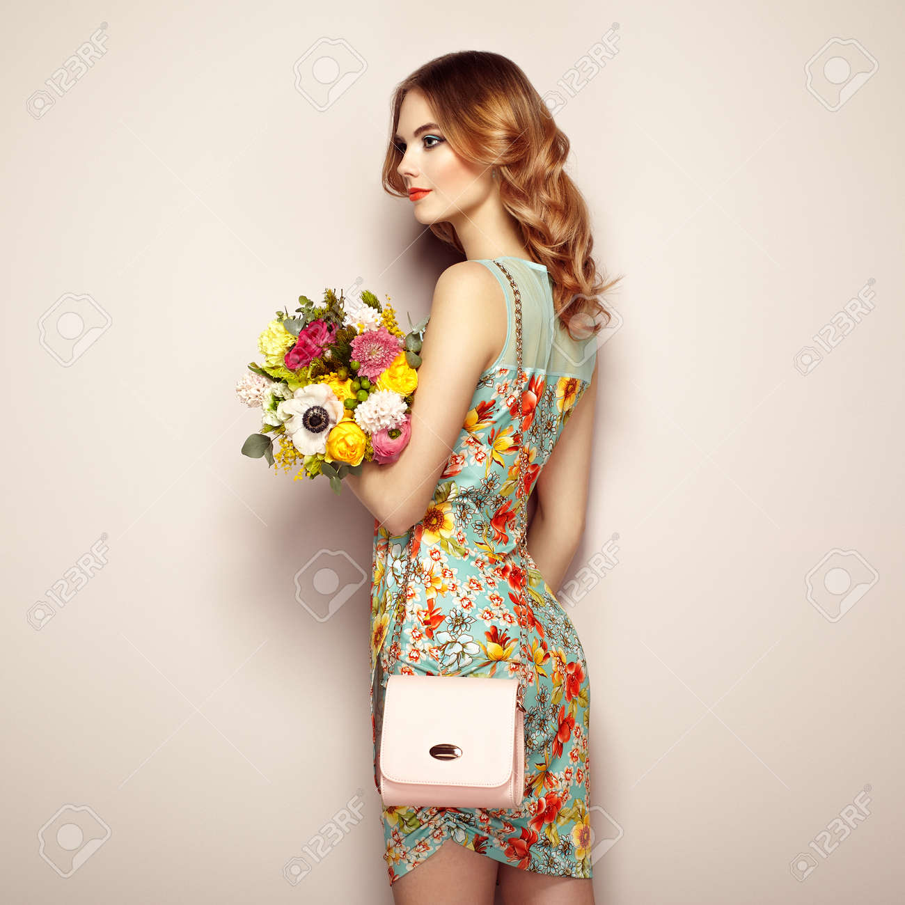 Blonde Young Woman In Elegant Floral Dress Girl Posing On A