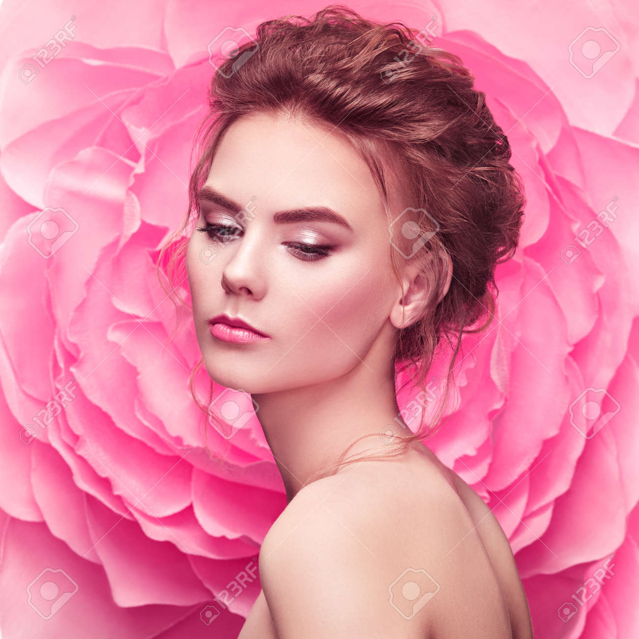 Beautiful woman on the background of a large flower. Beauty summer model girl with pink peony. Young woman with elegant hairstyle and makeup. Fashion photo - 78843194