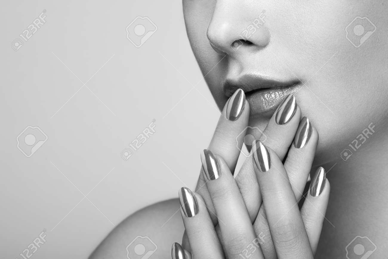 Beauty woman with perfect makeup. Lips and nails. Skin care foundation. Beauty girls face isolated on light background. fashion Black and White photo - 81236055