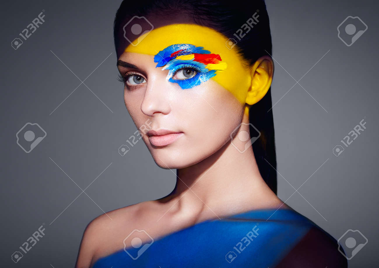 Fashion Model Woman With Colored Face Painted Beauty Fashion