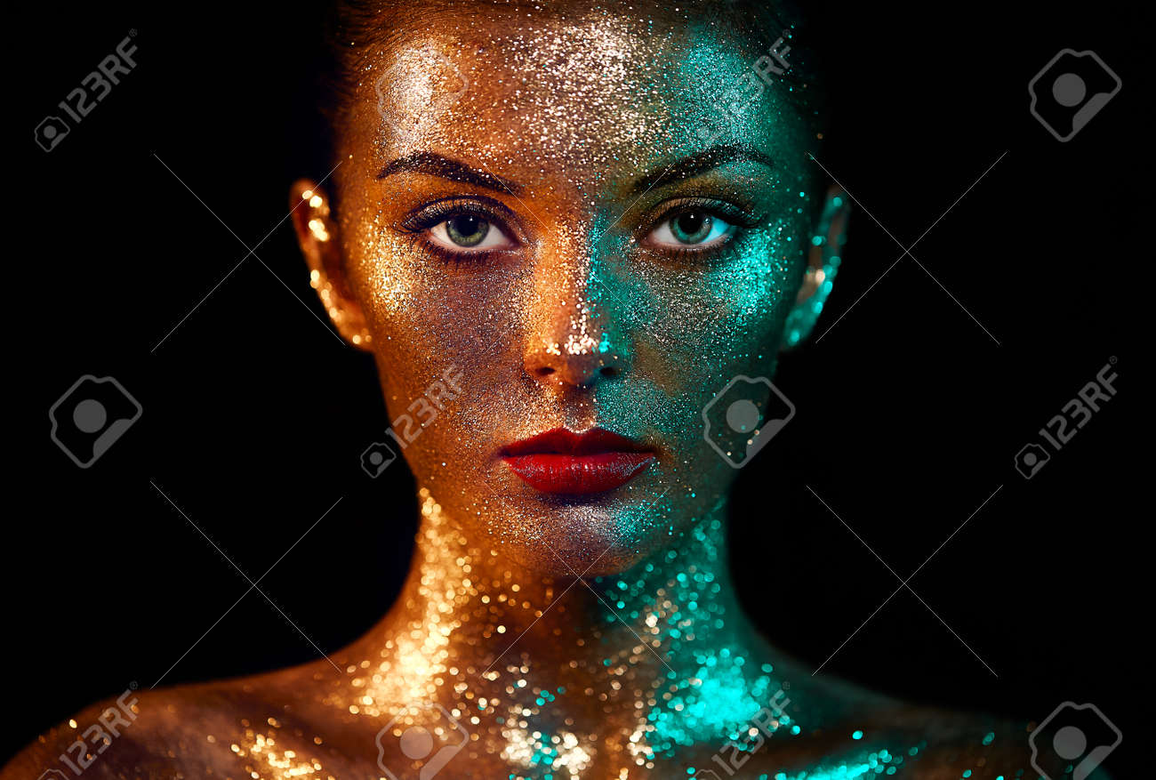 Portrait of Beautiful Woman with Sparkles on her Face. Girl with Art Make-Up in Color Light. Fashion Model with Colorful Makeup - 88595302