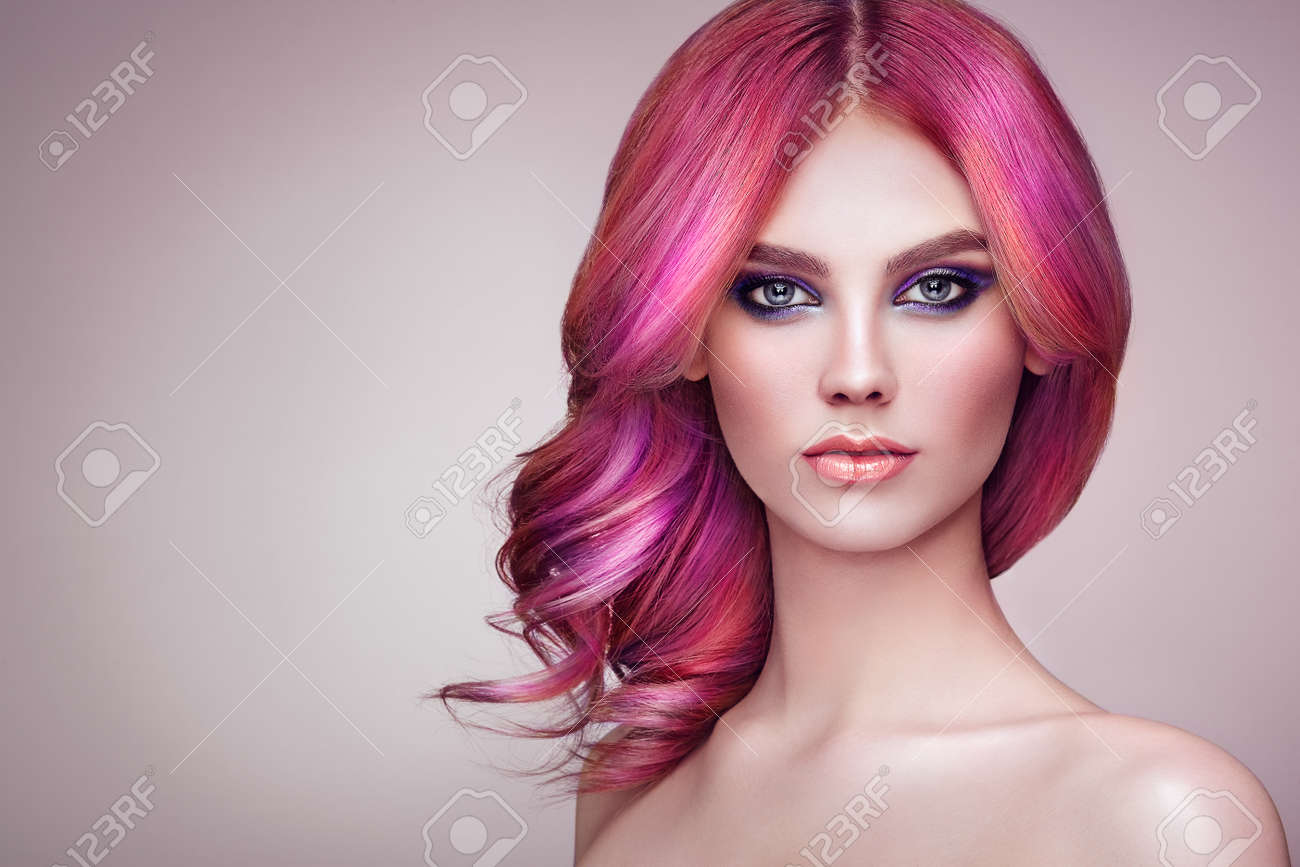 Beauty Fashion Model Girl with Colorful Dyed Hair. Girl with perfect Makeup and Hairstyle. Model with perfect Healthy Dyed Hair. Rainbow Hairstyles - 100318991