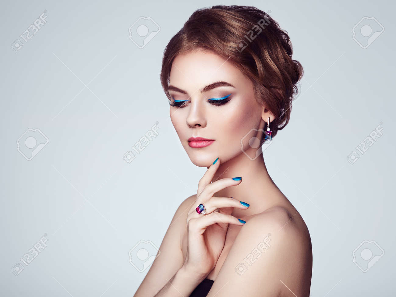 Portrait Beautiful Woman with Jewelry. Model Girl with Blue Manicure on Nails. Elegant Hairstyle. Blue Make-up Arrows. Beauty and Accessories - 110542234