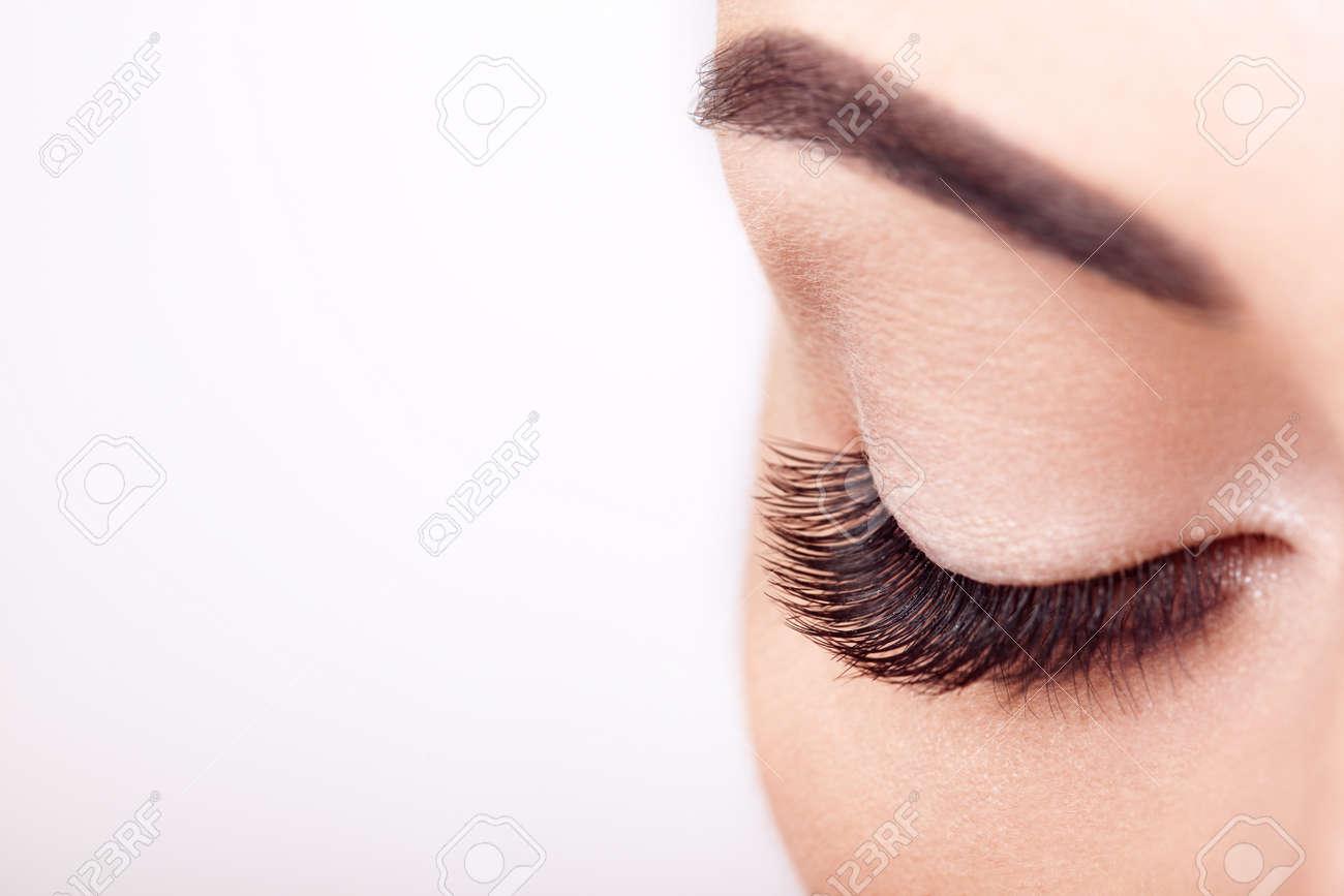 Female Eye with Extreme Long False Eyelashes. Eyelash Extensions. Makeup, Cosmetics, Beauty. Close up, Macro - 112453689
