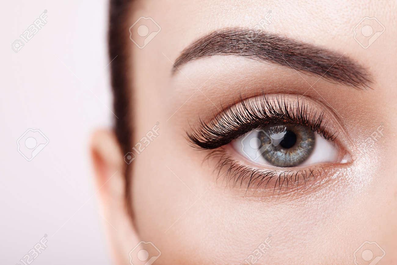 Female Eye with Extreme Long False Eyelashes. Eyelash Extensions. Makeup, Cosmetics, Beauty. Close up, Macro - 112453697