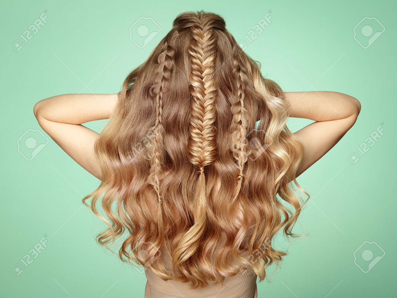 Blonde Girl with Long and Shiny Curly Hair. Beautiful Model Woman with Curly Hairstyle. Care and Beauty Hair Products. Lady with braided hair - 112453795