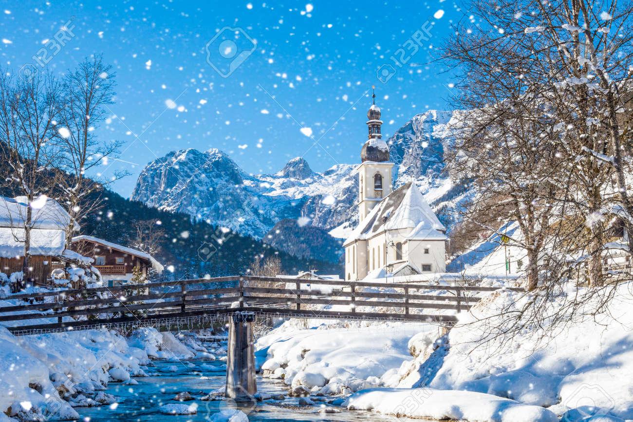 Snowfall in Ramsau, the parish church Saint Sebastian in winter, Ramsau, Berchtesgaden, Bavaria, Germany - 121549419