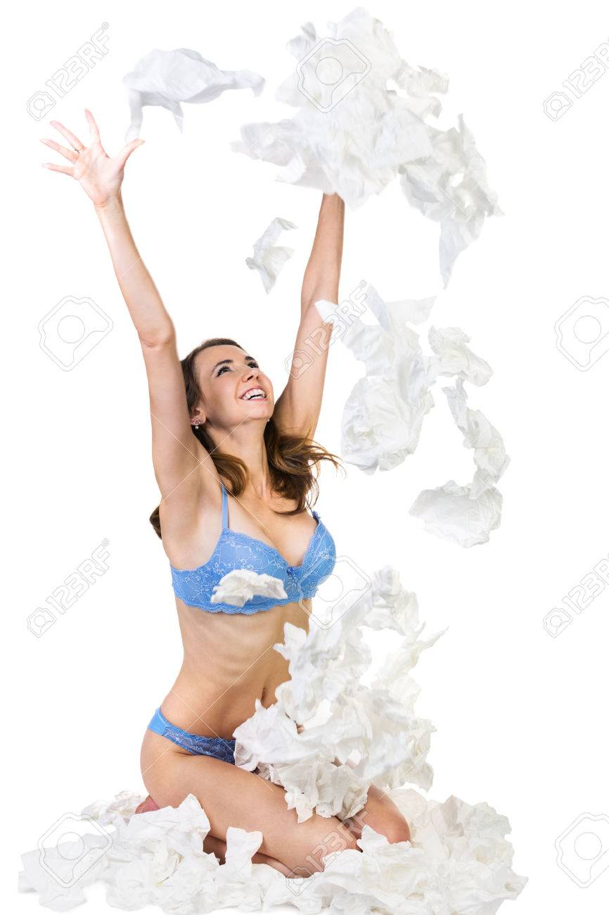 Happy woman throw up a lot of hankys. Isolated on white background Stock Photo - 25351969