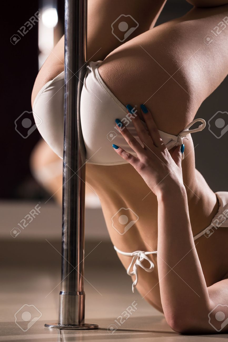 27159033-Young-slim-pole-dance-woman--Stock-Photo.jpg