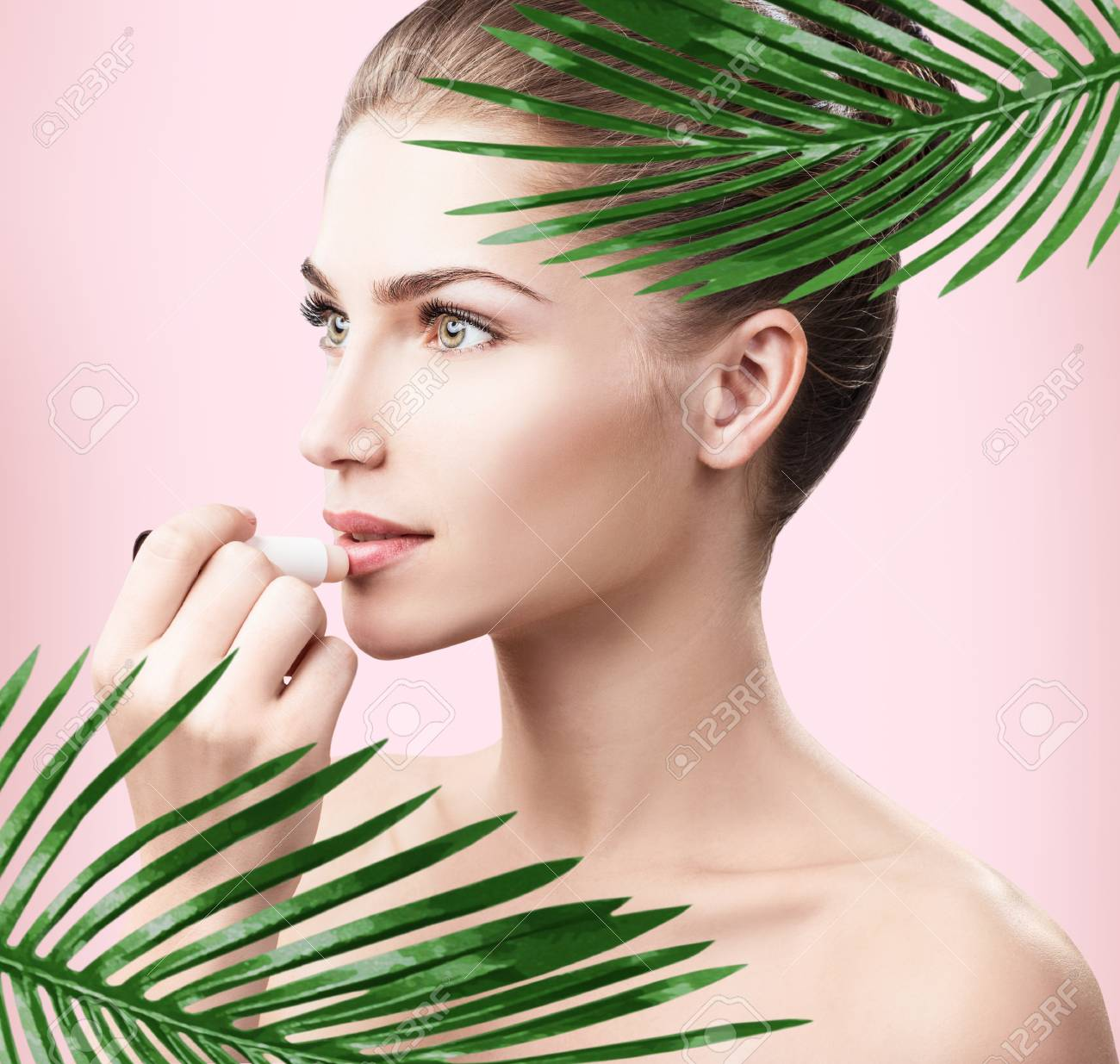 68cdace11771b Beautiful woman with perfect skin among palm leaves. Stock Photo - 97855017