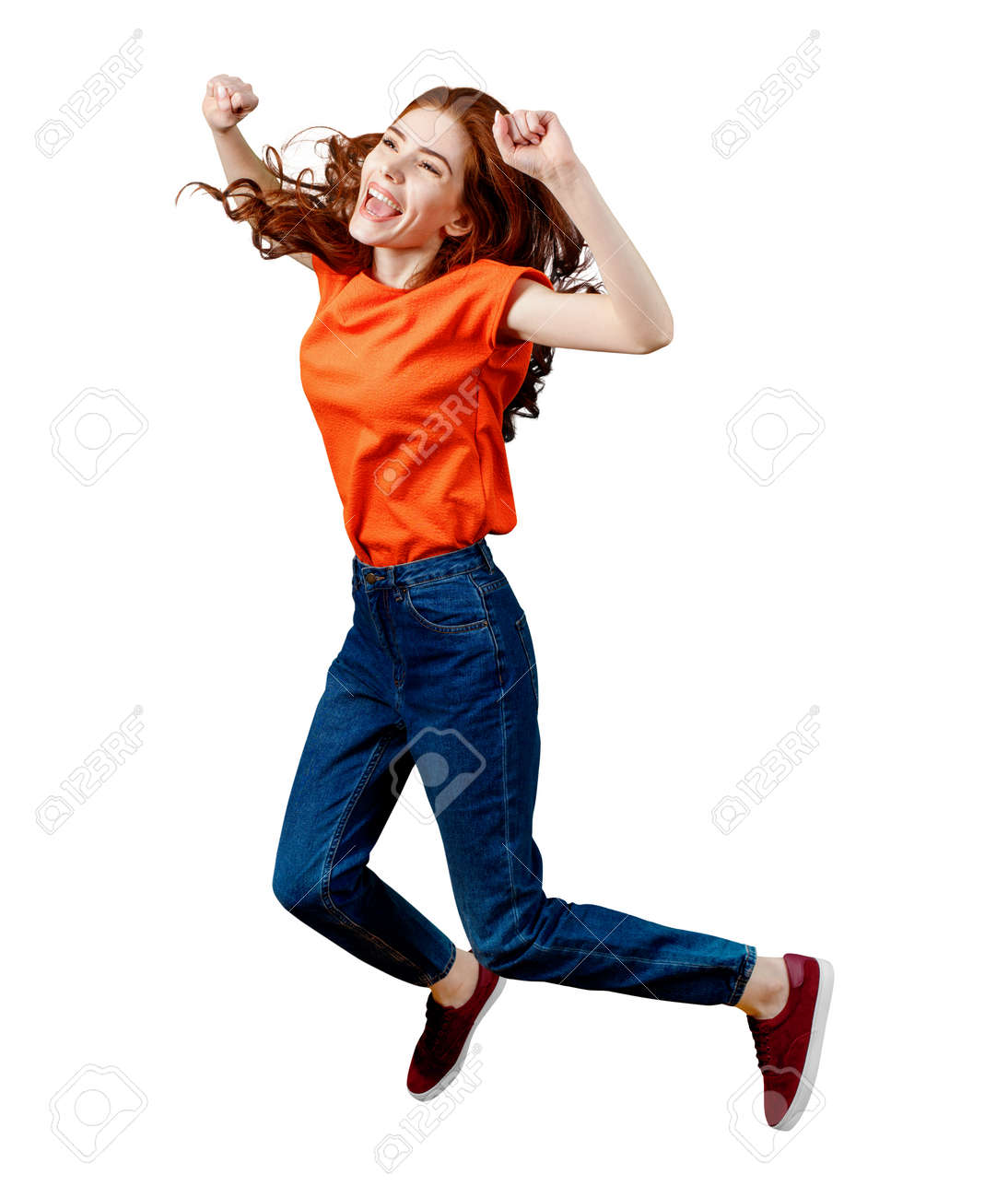 Full length happy ginger woman in shirt and jeans jumping. - 120492778