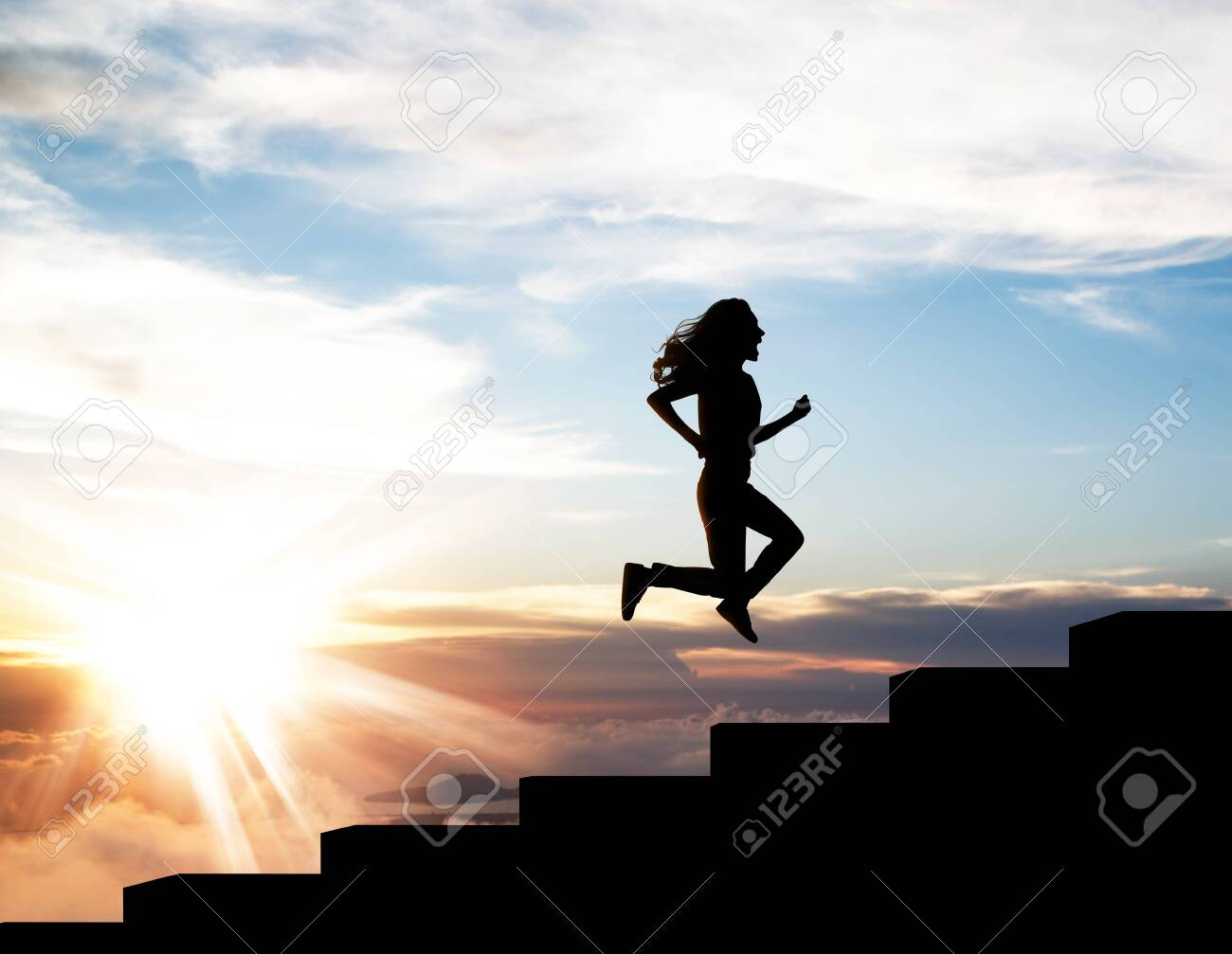 Black silhouette of woman running up on the staircase in sunset. - 140196127
