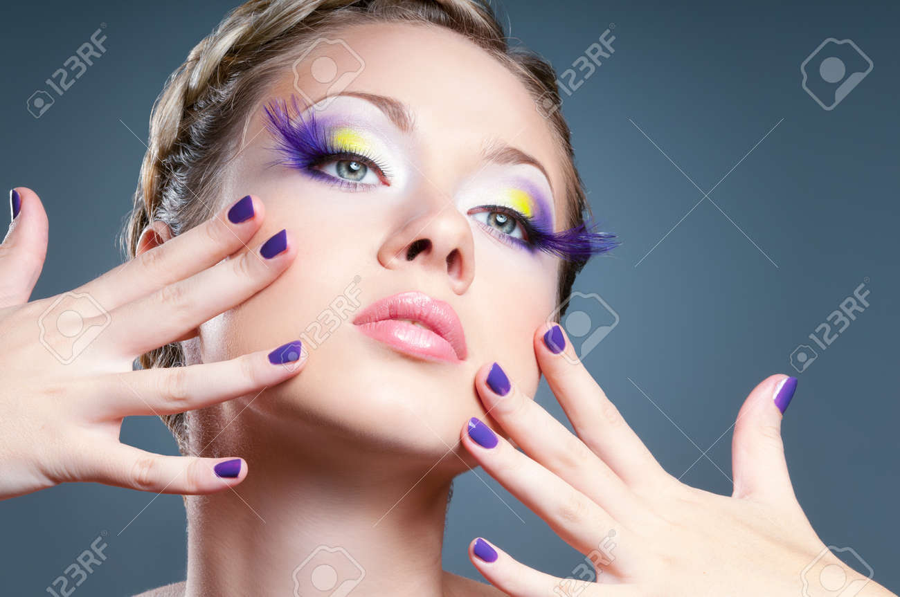 Woman face with bright violet makeup Stock Photo - 11710502