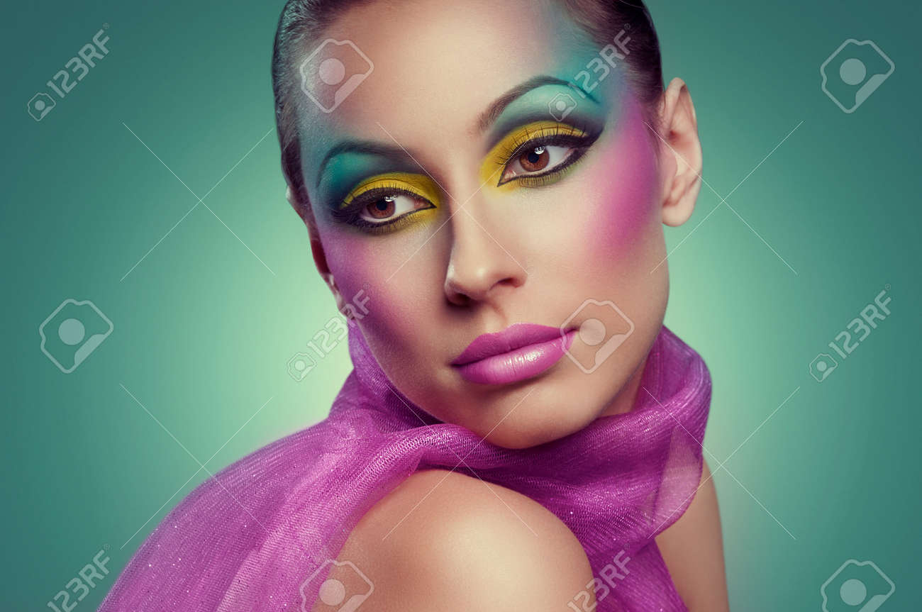 Woman face with creative many-coloured makeup Stock Photo - 17383439