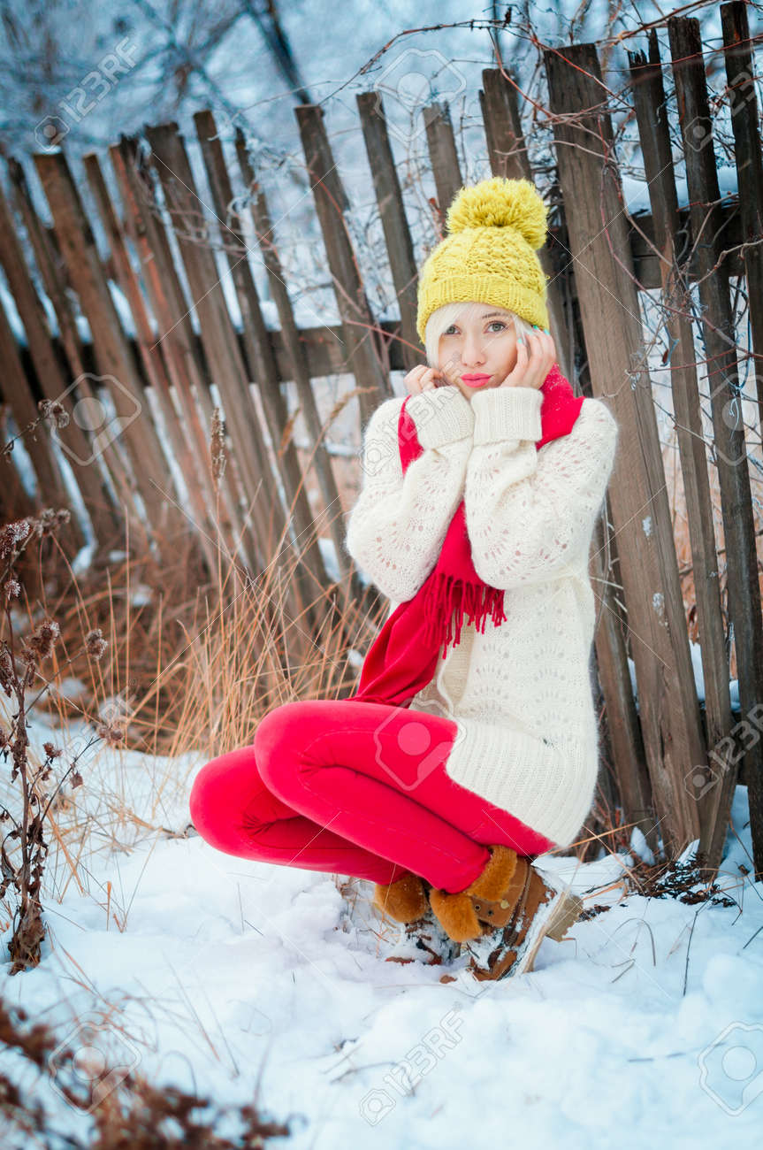 Winter blonde Woman portrait. Beautiful fashion model girl in bright hat and scarf Stock Photo - 17473094