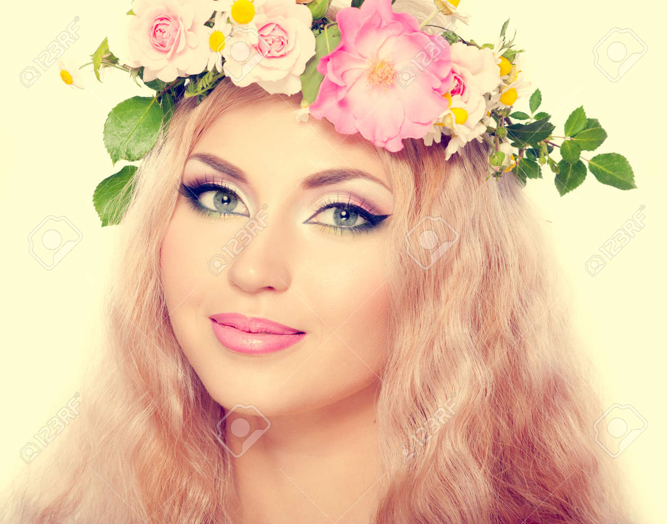 Beautiful woman with bright makeup and blonde long hair with beautiful woman with bright makeup and blonde long hair with flowers stock photo 29391132 dhlflorist Gallery